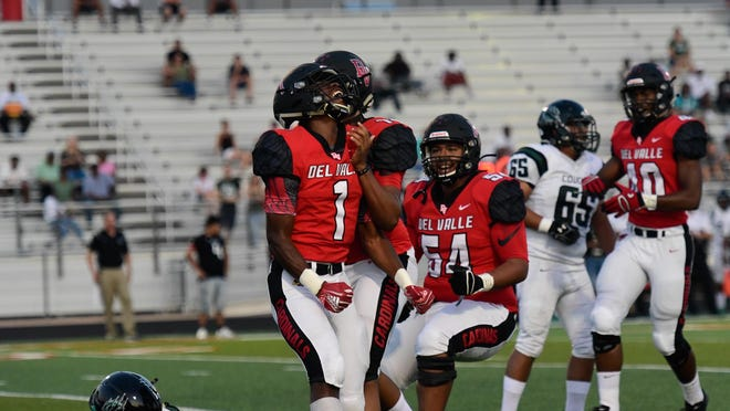 Del Valle linebacker Kaleb Brown, left, celebrates a sack in a nondistrict win over Connally last season. Brown returns as arguably the best linebacker in District 26-6A.