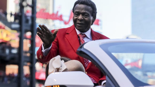 Cardinals Hall of Famer Lou Brock waves to the crowd on opening day in 2018 at Busch Stadium in St. Louis.