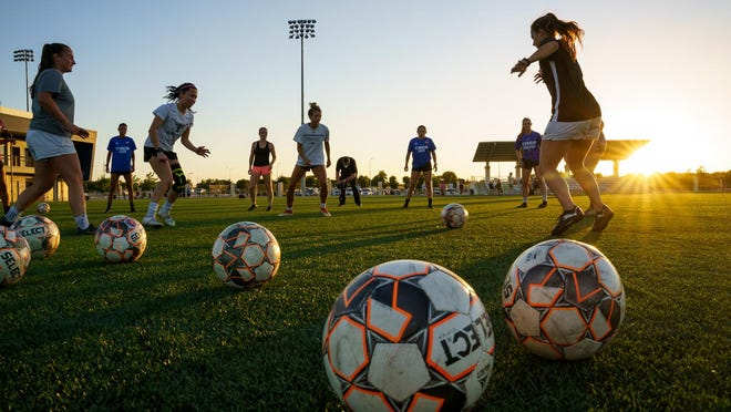 FC Austin Elite players perform a passing drill as practices resume Wednesday in Round Rock. The team will begin preparing for the UWS National Cup next month.