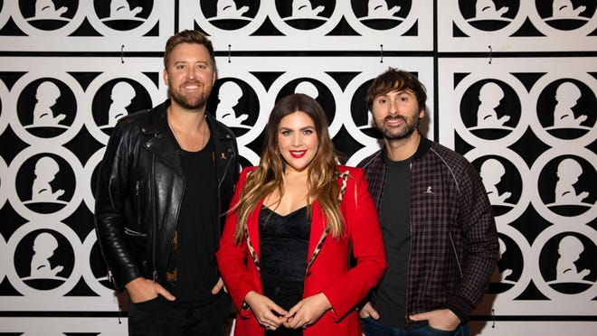 From left to right, Charles Kelley, Hillary Scott and Dave Haywood of Lady Antebellum attend the Country Cares for St. Jude Kids Seminar at The Peabody in January n Memphis, Tennessee.