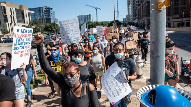 Protesters march toward Austin City Hall during the Educators March for Justice protest Friday. The protest was organized by teachers and educators to stand up for Black students.