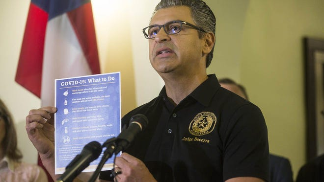 Hays County Judge Ruben Becerra announces a state of disaster because of the coronavirus pandemic during a news conference at the County Courthouse in March.