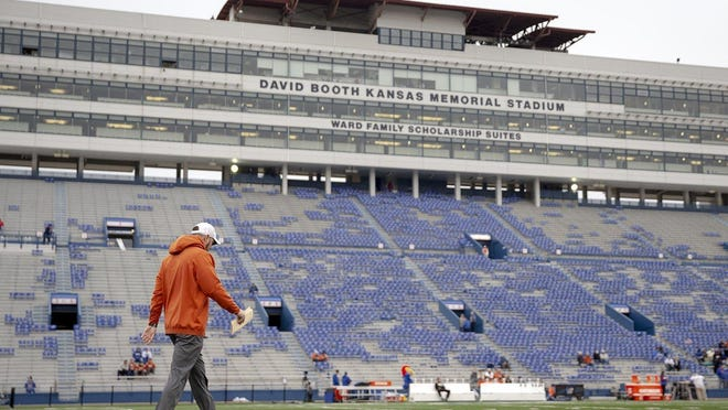 Texas head coach Tom Herman walks the field of Kansas' Memorial Stadium before the 2018 game in Lawrence. Herman has gone 27-16 so far with the Longhorns.