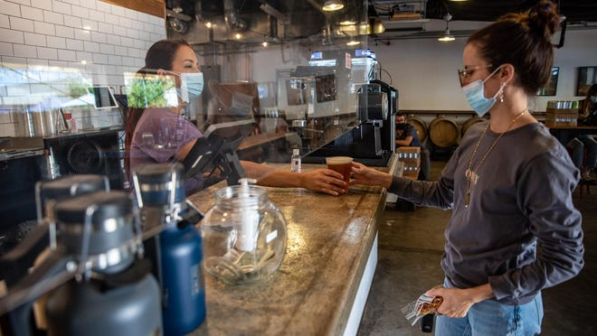 Andrea Taylor orders a beer at St. Elmo Brewing Company on Sept. 29, 2020. St. Elmo has made some major adjustments in order to continue serving customers.