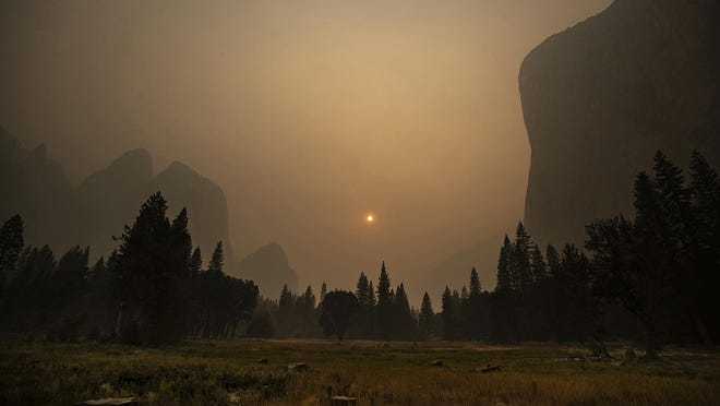 Thick smoke from multiple forest fires shrouds iconic El Capitan, right, and the granite walls of Yosemite Valley Sept. 12 in Yosemite National Park, California.