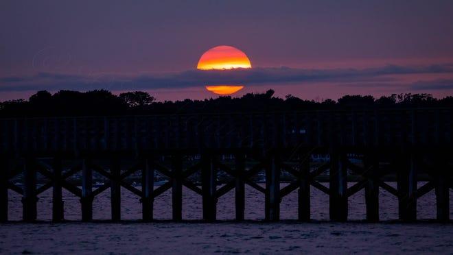 Laurie Wenham captured this stunning sunset shot over Duxbury's Powder Point Bridge this week.