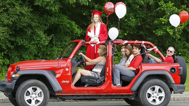 Milton High graduate Shae Burns and her family join her fellow graduates in a drive-by graduation ceremony Sunday, June 7, 2020. Greg Derr/The Patriot Ledger