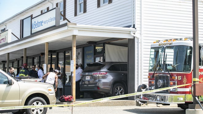 Brockton police and firefighters responded to a vehicle into a building after a 23-year-old woman drove her gray Toyota Highlander into the Beltone Hearing Aid Center, at 830 Belmont St., in Brockton, Monday afternoon, July 27, 2020.