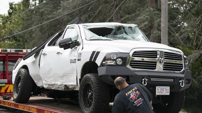 A white Dodge Ram 1500 pickup truck and a black sedan were involved in a rollover crash at the intersection of Summer and Plymouth streets in Abington on Thursday, Aug. 27, 2020.