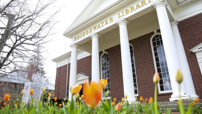 FILE - Tulips bloom in front of the Bridgewater Public Library on Easter Sunday, April 21, 2019.