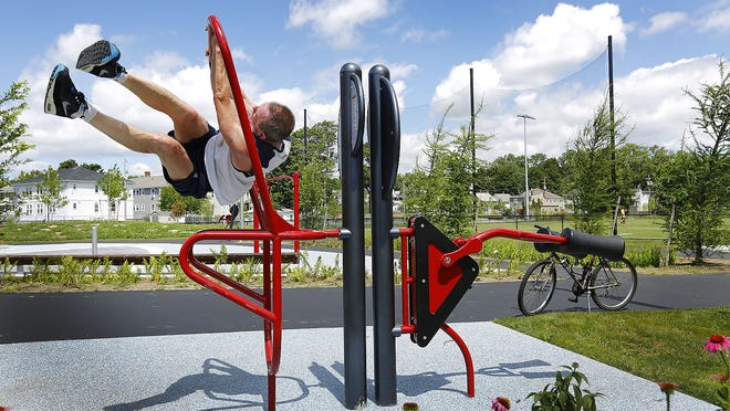 Scott Peckham, of Quincy, uses the Heath Beat crossfit course in the newly renovated Kincaide Park off water Street in Quincy.