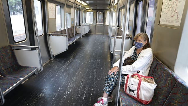 Marie Jackson-Miller rides the nearly empty Red Line from Boston back home to Quincy on Wednesday, July 8.