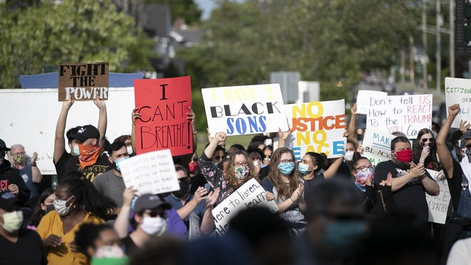 Over 1,000 people gathered at West Middle School in Brockton for a peace rally, sparked by the death of George Floyd in Minneapolis police custody, on Tuesday, June 2, 2020. City officials are concerned about a potential spike in COVID-19 cases due to the number of people attending protests during the ongoing pandemic.