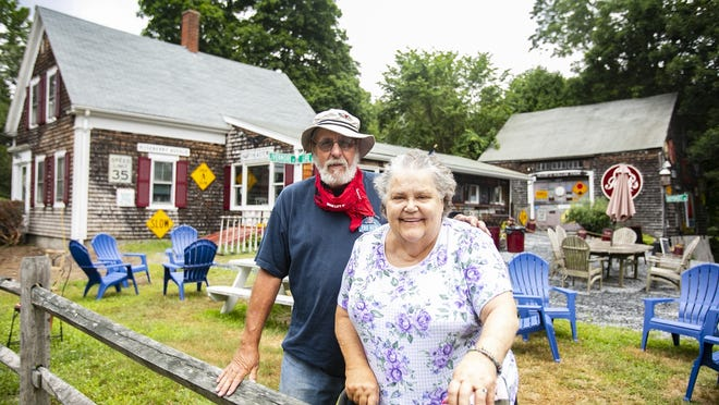 Tony, 75, and Lynda Quigley, 75, pose for a photograph outside HeidiþÄôs Hollow Farm in Hanson on Tuesday, July 14, 2020. The QuigleyþÄôs have owned the ice cream shop and sold antiques out of the barn since 1989 but have decided to retire south.