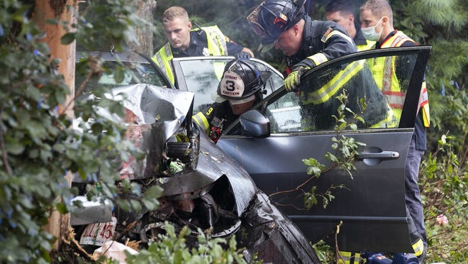 Easton firefighters use hydraulic rescue tools, known as the Jaws of Life, to extricate a female driver that crashed into a tree at 415 Main St. in Easton, on the Brockton line, Thursday, Aug. 27, 2020. The driver was transported by an Easton ambulance to Good Samaritan Medical Center in Brockton.
