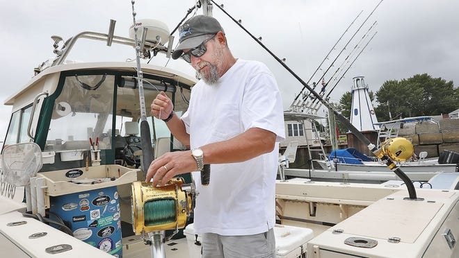 Captain Greg Ares, on the Rock-On in Green Harbor, is rigging to fish on Wednesday, July 15, despite an uncertain bluefin tuna market. Greg Derr/The Patriot Ledger