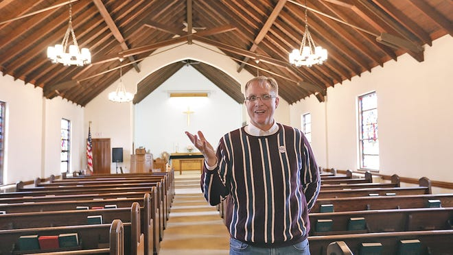 Revered Doug Grey in the church sanctuary.  The First Church of Squantum is making renovations to the church including the entryway, kitchen and bathrooms on Tuesday September 22, 2020  Greg Derr/ The Patriot Ledger