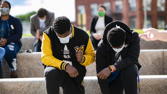 During the prayer vigil outside Brockton City Hall people took a knee for peace and healing on Monday evening, June 1, 2020.
