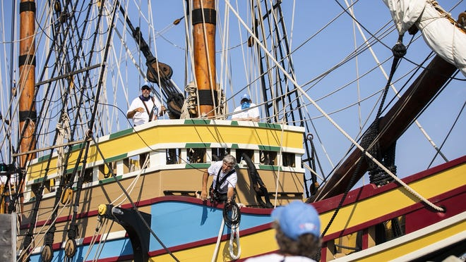 Crew members aboard the Mayflower II throw lines to crew members as they work to dock the historic ship in Plymouth Harbor on Monday, Aug. 10, 2020. The tall ship spent two years in Mystic Seaport, CT for restorations.