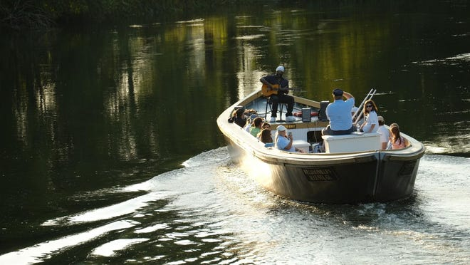 Guests enjoy a relaxing evening of music on board an Augusta Canal Authority music cruise.