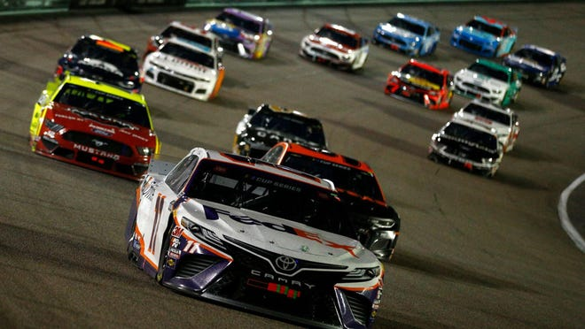 Denny Hamlin, driver of the #11 Toyota, leads a pack of cars during the NASCAR Cup Series Dixie Vodka 400 at Homestead-Miami Speedway on Sunday in Homestead, Florida.
