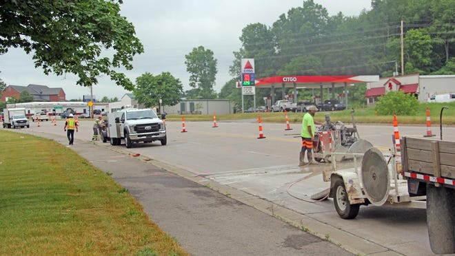 Contractors with Diamond Concrete Sawing begin to cut away bad patches of concrete Tuesday in preparation for patching.