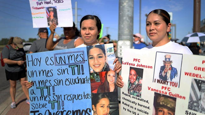 Krysta Martinez, left, along with her sister Kathryn Martinez, are among the dozens of protesters who gathered in Killeen outside the gates of Fort Hood on Friday demanding that officials find Pfc. Vanessa Guillen, who was last seen in the Army post April 22.