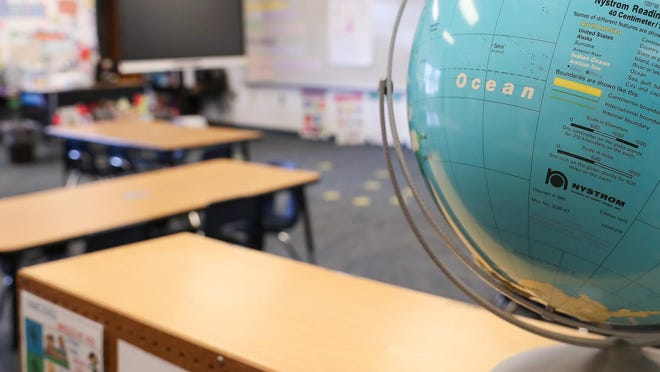 Gov. Roy Cooper announced Thursday that North Carolina school districts will have the option to bring young students back into the classroom starting next month.