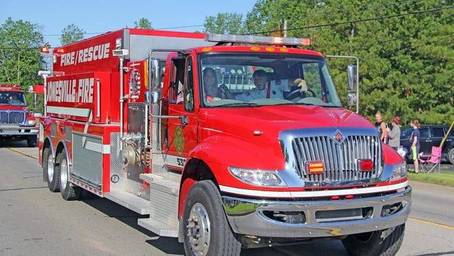 Jonesville Fire Chief Dean Adair drives Jonesville's pumper/tanker combo in the 2019 Memorial Day parade.