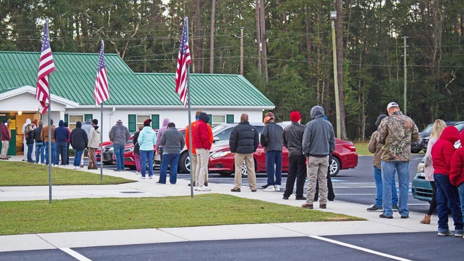 People lined up to vote at 7 a.m. Tuesday at Rincon Baptist Temple.
