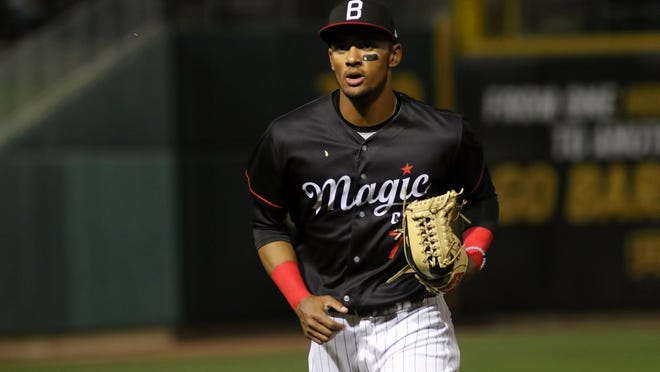 Birmingham (Ala.) outfielder Joel Booker, a former Polk County High standout, makes his way off the field during the Barons' home opening series against Tennessee last season.