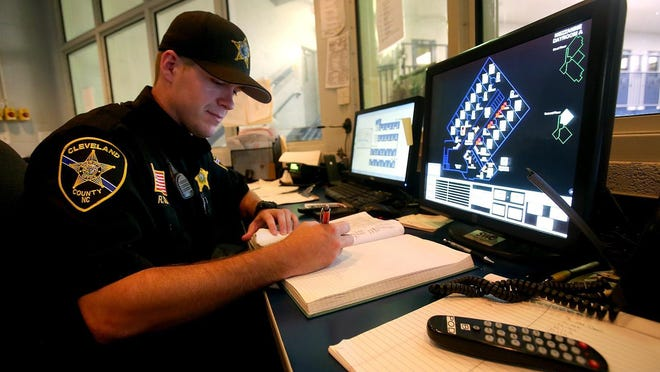 Detention Officer Ricky Cody II works inside the control center at the Cleveland County Jail Annex. This year's county budget will allow the addition to three new detention officers.