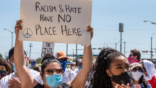 Protesters gather in front of the Caldwell County Justice Center in Lockhart on June 13. Protests about systemic racism spread throughout the country this summer. The protests and the disproportionate ways the coronavirus has affected people of color inspired the Hogg Foundation to issue a declaration that racism is a mental health problem.