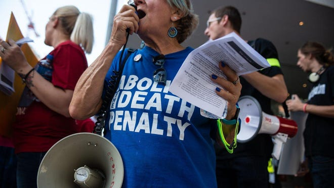 In this 2019 file photo, Gloria Rubac leads chants during the 20th Annual March to Abolish the Death Penalty in Austin.