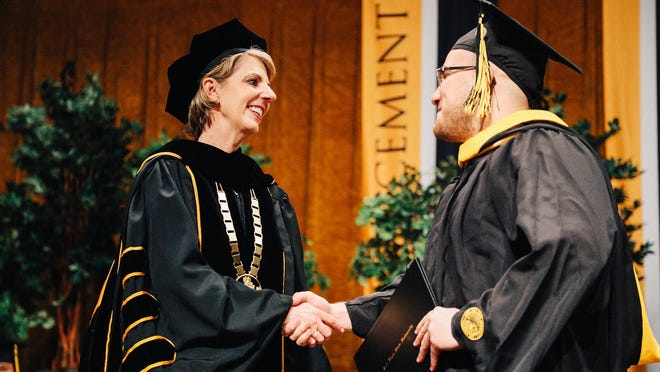 FHSU President Tisa Mason congratulates a graduating student during a past commencement ceremony at the university.