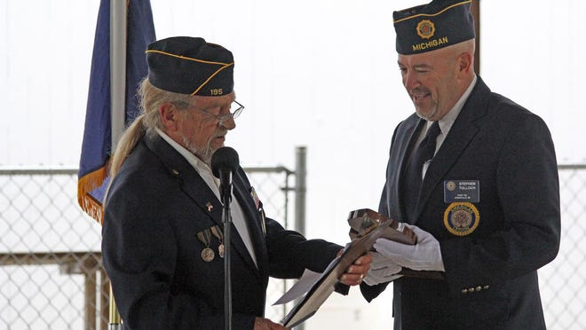 Hillsdale County Veteran of the Year Committee Chairman Gary Noblit presents a plaque to the Stephen Tulloch, the 2020 Veteran of the Year.