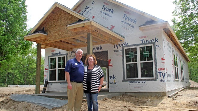Eric and Nicole Hoffman were on site of their development community Thursday to inspect work done thus far.