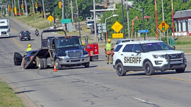 Emergency personnel conducted traffic control operations on U.S. 12 while a flatbed wrecker worked to remove a damaged vehicle from the roadway Thursday morning.