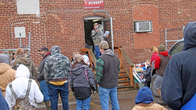 Litchfield Outdoors owner Dave Tefft announces the tip-up winners Sunday afternoon in the parking lot of Litchfield Outdoors.