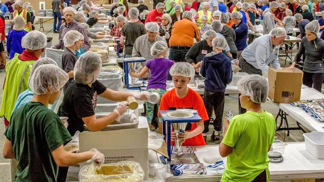 Volunteers pack meals in the gymnasium at Green Bay Community Church on Wednesday, Oct. 1, during this year's Feed My Starving Children mobile pack. Nearly 2,200 volunteers from nine area churches packed 466,560 meals during the four-day initiative that were to be shipped to more than 70 countries.