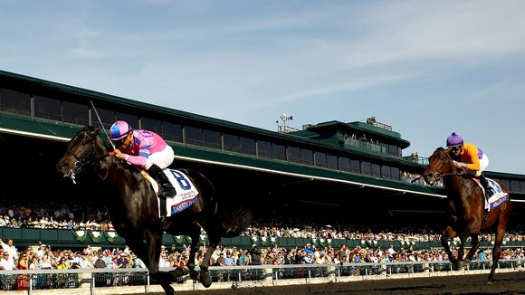 Dance With Fate beats Medal Count at Keeneland Race Course in Lexington in April. An average of 24 horses die each week at U.S. racetracks, a 2012 New York Times series reported.  Getty Images LEXINGTON, KY - APRIL 12:  Dance With Fate, ridden by Corey Nakatani, crosses the finish line ahead of Medal Count #13, ridden by Robby Albarado, to win the Toyota Blue Grass Stakes at Keeneland Race Course on April 12, 2014 in Lexington, Kentucky.  (Photo by Matthew Stockman/Getty Images)