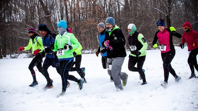 Runners take part in #TrailRoc's 0 Degree Winter Trail Festival (WTF) race. Trail running takes place in every weather condition.