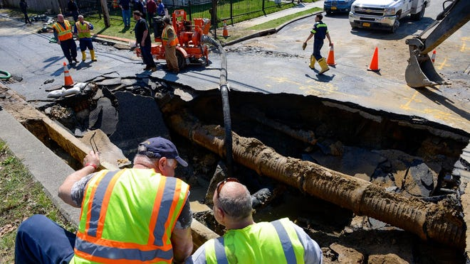 Crews work on a broken water main that affected traffic in the Executive Boulevard area of Yonkers on Monday.