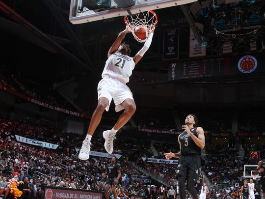 Jordan Brown dunks during the McDonald's High School All-American Game at Philips Arena in Atlanta.