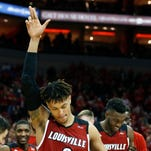 """Louisville's Damion Lee throws up and """"L"""" as he walks off the court  on Senior Night.  Mar. 1, 2016"""