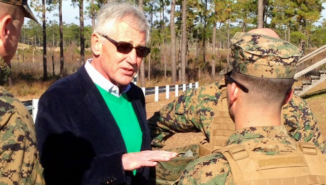 Defense Secretary Chuck Hagel talks to Marines at a training range at Camp Lejeune, N.C.