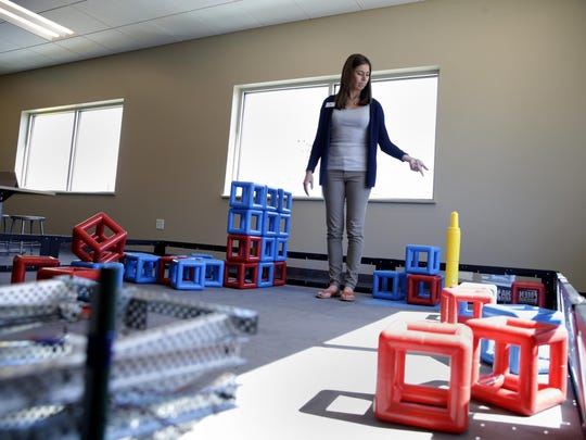 Stephanie Lehrer, branch director of the Boys & Girls Club of Menasha, points out some of the items used in the STEM and Robotics Lab. The club will open to youth on Monday.