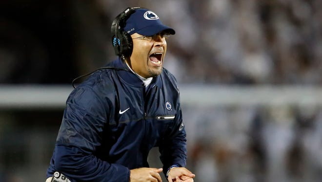 Penn State coach James Franklin reacts after an extra point against Ohio State during the second half of an NCAA college football game in State College, Pa., Saturday, Oct. 22, 2016. Penn State won 24-21.