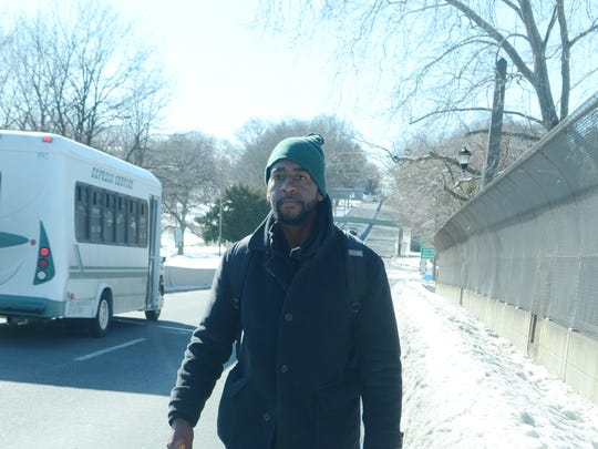 The unplowed sidewalk on the Route 4 overpass above Route 20 in Paterson forced Eric Barnes to walk along the busy highway on Friday.