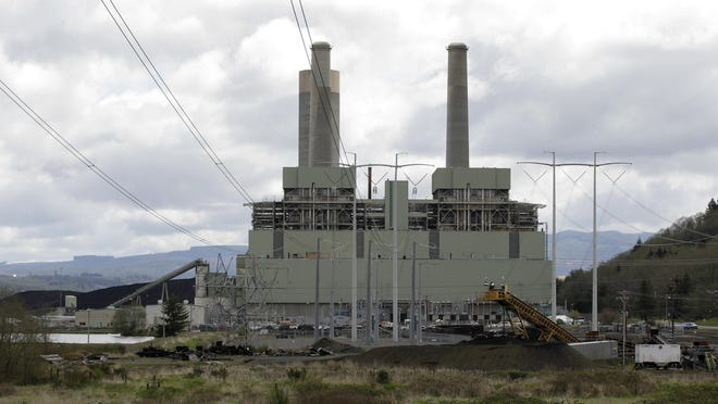 FILE - In this April 29, 2011, file photo, the coal-burning TransAlta plant is shown near Centralia, Wash. Washington Gov. Jay Inslee says the state plans to sue the Trump administration over its proposal to dismantle Obama-era pollution rules that would have increased federal regulation of emissions of coal-fired power plants. Inslee, a Democrat, told reporters Wednesday, Aug. 22, 2018, that the Environmental Protection Agency plan threatens lives and is also illegal. (AP Photo/Ted S. Warren, File)